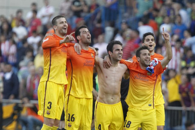 atletico 1-2 fc barcelona players celebrate liga 2013