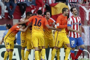 atletico 1-2 fc barcelona players celebrate second goal 2013