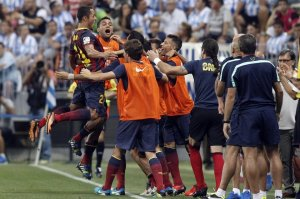 malaga 0-1 barcelona adriano celebrates goal with bench 2013