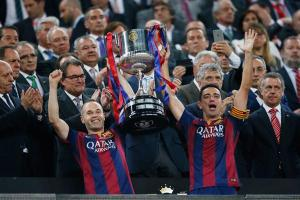 Iniesta and Xavi receive Copa del Rey trophy 2015